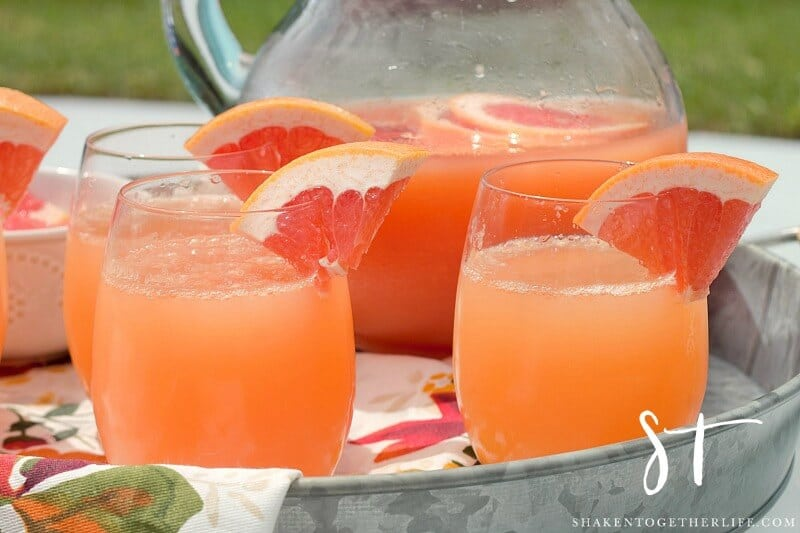 Bright and bubbly, these Ruby Red Grapefruit Mimosas will be the life of the party! This easy 2 ingredient cocktail recipe is perfect for pool parties, a day with the girls and brunch!