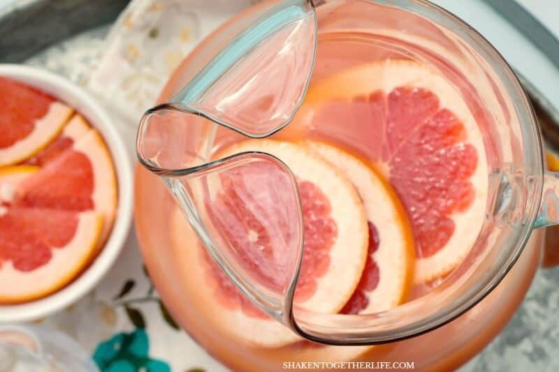 Ruby Red Grapefruit Mimosas in glass and pitcher