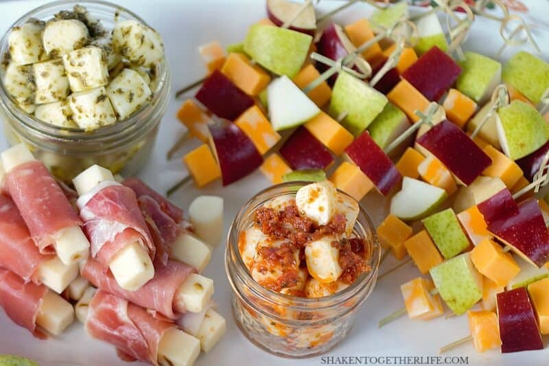 3 EASY Cheesy Appetizers - these simple cheese appetizers start with cheese sticks! Pesto mozzarella bites, prosciutto wrapped pepper jack and fruit & cheese skewers are simple, delicious and perfect for entertaining!