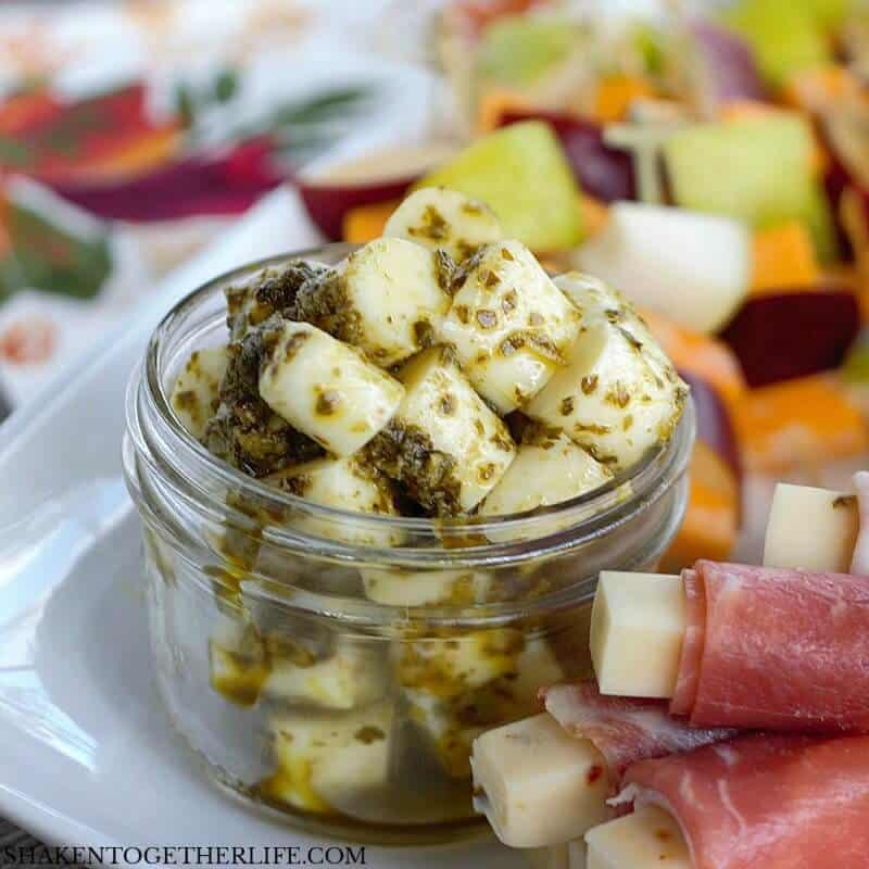 3 Easy Cheesy Appetizers made with cheese sticks - Pesto Mozzarella Bites