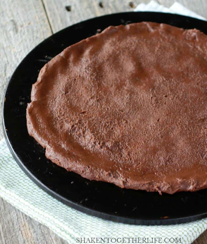 Our Pumpkin Patch Dessert Pizza starts with a rich chocolate brownie crust made from a brownie mix!