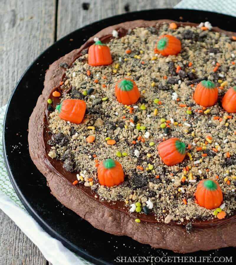 Mellowcreme candy pumpkins fill the field of our Pumpkin Patch Dessert Pizza! What an adorable Halloween or Fall dessert idea!