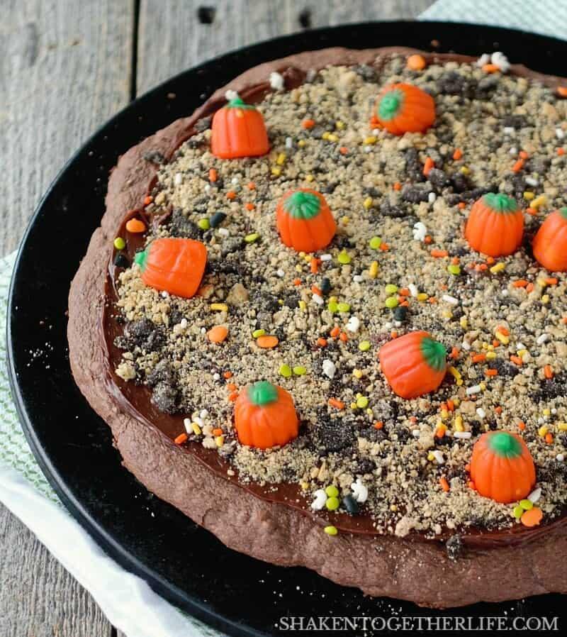 Mellowcreme candy pumpkins fill the field of our Pumpkin Patch Dessert Pizza! What an adorable Halloween or Fall dessert idea!