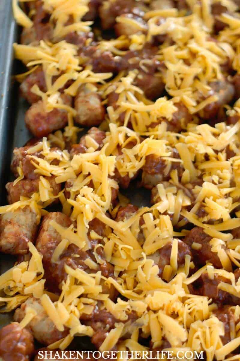 Another secret to the ooey gooiest Sheet Pan Chili Cheese Tater Tots? Freshly grated cheese!