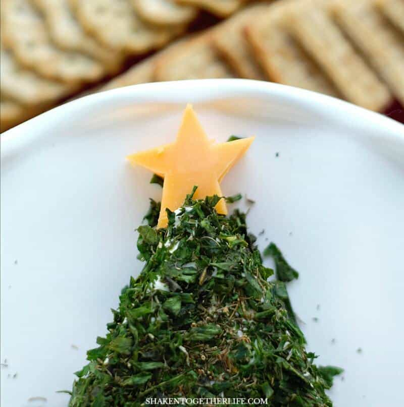 A cheddar cheese star tops this Cream Cheese Christmas Tree Appetizer