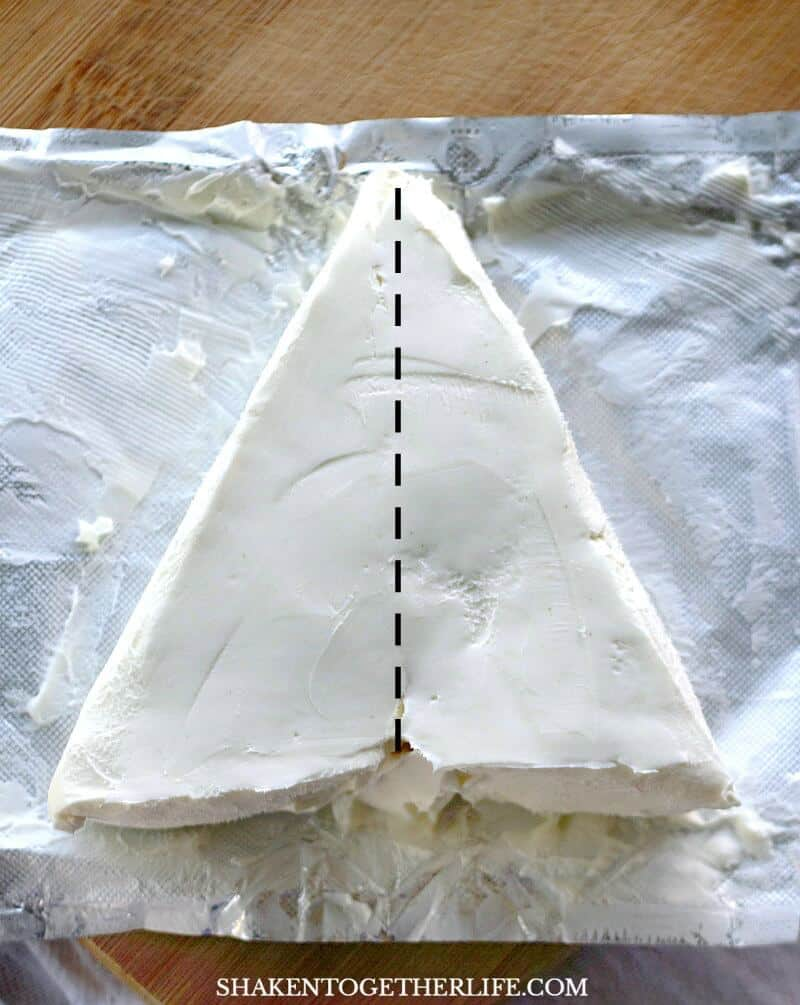 One simple knife cut transform a block of cream cheese into a Christmas tree for this easy Cream Cheese Christmas Tree Appetizer!