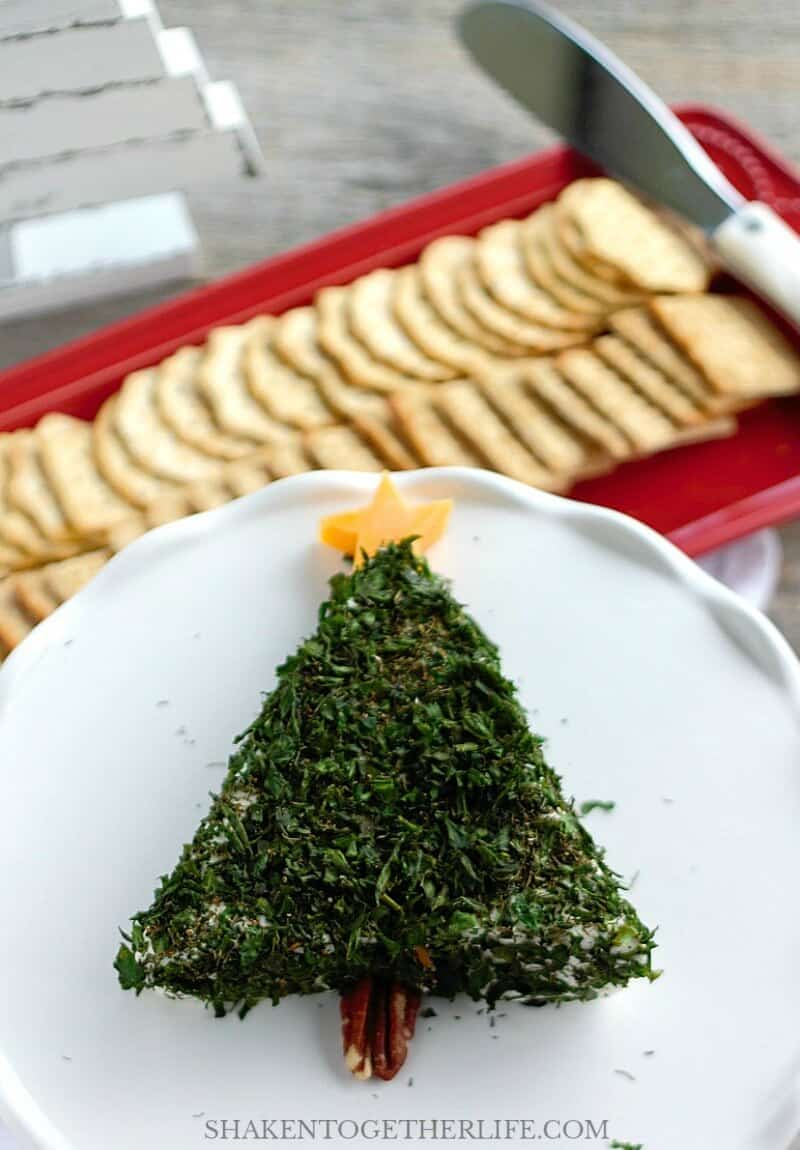Serve this Cream Cheese Christmas Tree Appetizer with crackers, toasted baguette rounds, pita chips or even fresh veggies!