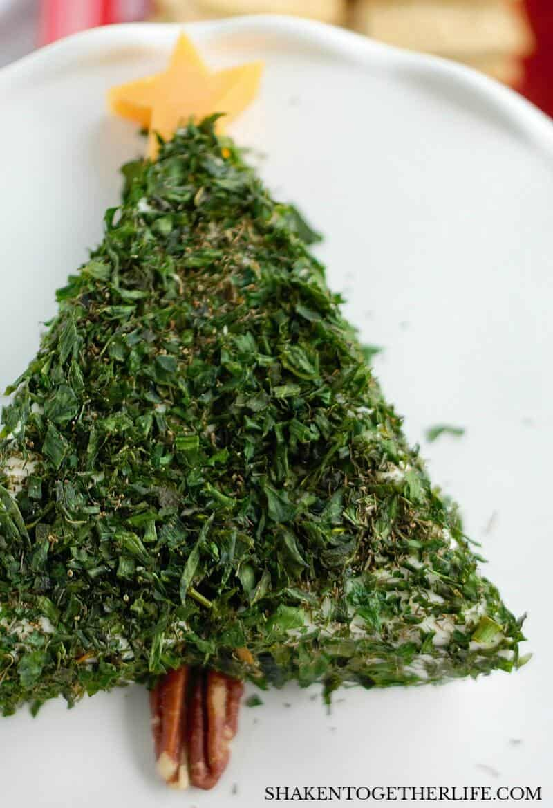 A pecan half makes the trunk of this Cream Cheese Christmas Tree Appetizer - what an easy, festive holiday appetizer!