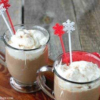 Warm and comforting, Creamy Eggnog Hot Chocolate blends two holiday favorites into one decadent, rich holiday drink!