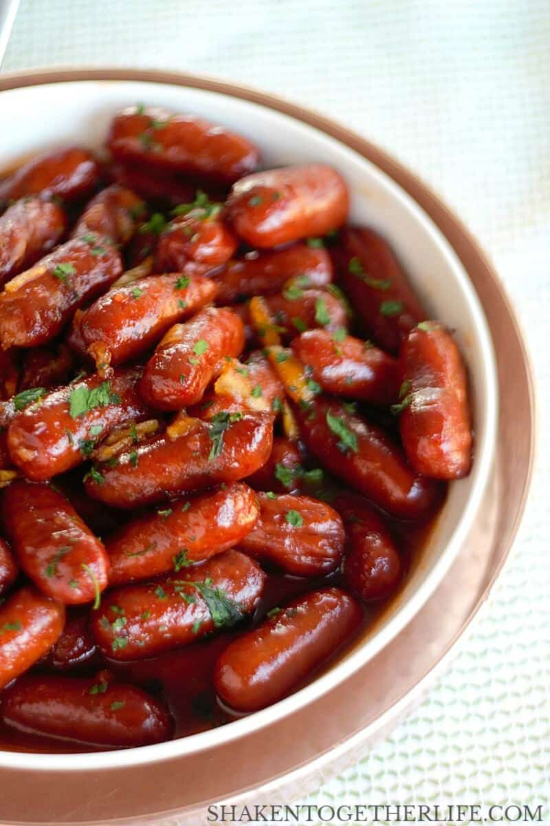 With just 3 ingredients, these Orange BBQ Little Smokies are a deliciously easy appetizer for the holidays, New Years Eve or the big game! You can make them on the stove top or in your slow cooker!