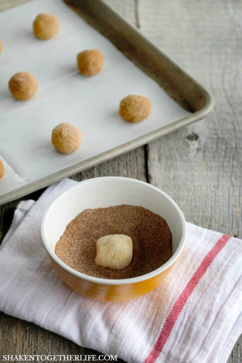 Super Simple Gingerbread Snickerdoodles start with classic sugar cookie dough rolled in fragrant gingerbread sugar!