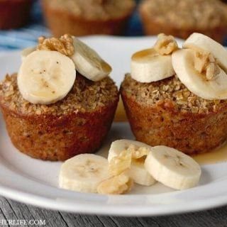 These Banana Bread Baked Oatmeal Cups are hearty, healthy and freezer friendly! Top with bananas, walnuts and a drizzle of syrup for a healthy breakfast!