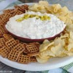 Creamy Cheesy Dill Pickle Dip is packed with tangy dill pickles, dill, garlic and sharp cheddar cheese. This game day appetizer dip is a touch down for sure!