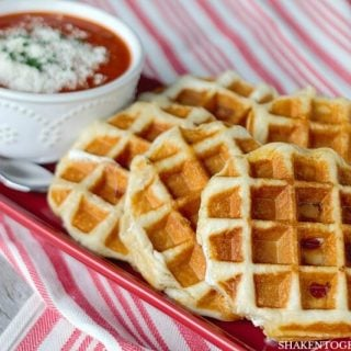Pizza Stuffed Waffles start with refrigerated biscuits then stuffed with creamy mozzarella, mini pepperoni and are waffled to perfection in about 5 minutes flat! What an easy dinner idea!