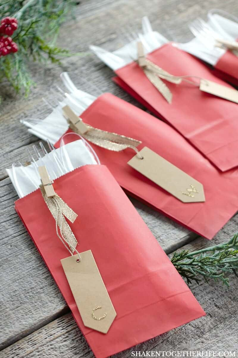10 Secrets for Holiday Entertaining & An Easy Holiday Place Setting - corral Chinet Cut Crystal cutlery and napkins in colorful paper bags! This is a fabulous idea for a buffet or these cutlery pockets can double as place cards!