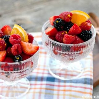 Orange & Brown Sugar Mixed Berry Salad is perfect for any season! This easy 4 berry salad is delicious served alone or spooned over ice cream, angel food cake or pound cake!