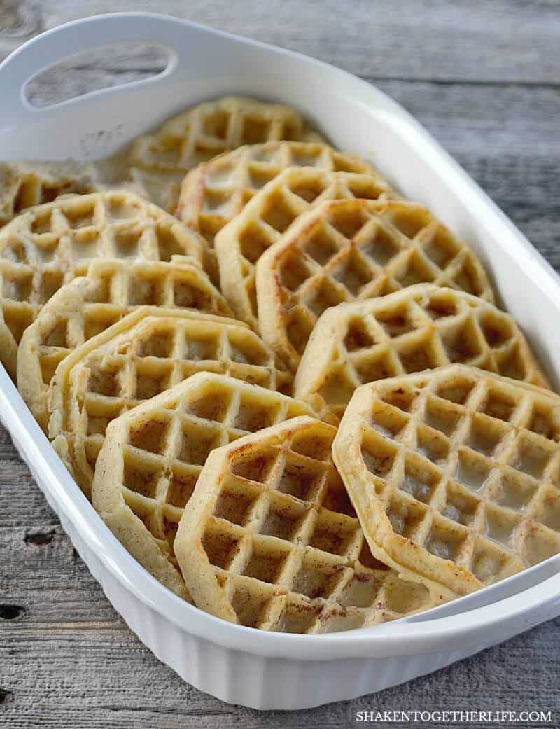 Overnight Waffle Breakfast Casserole in a white casserole dish