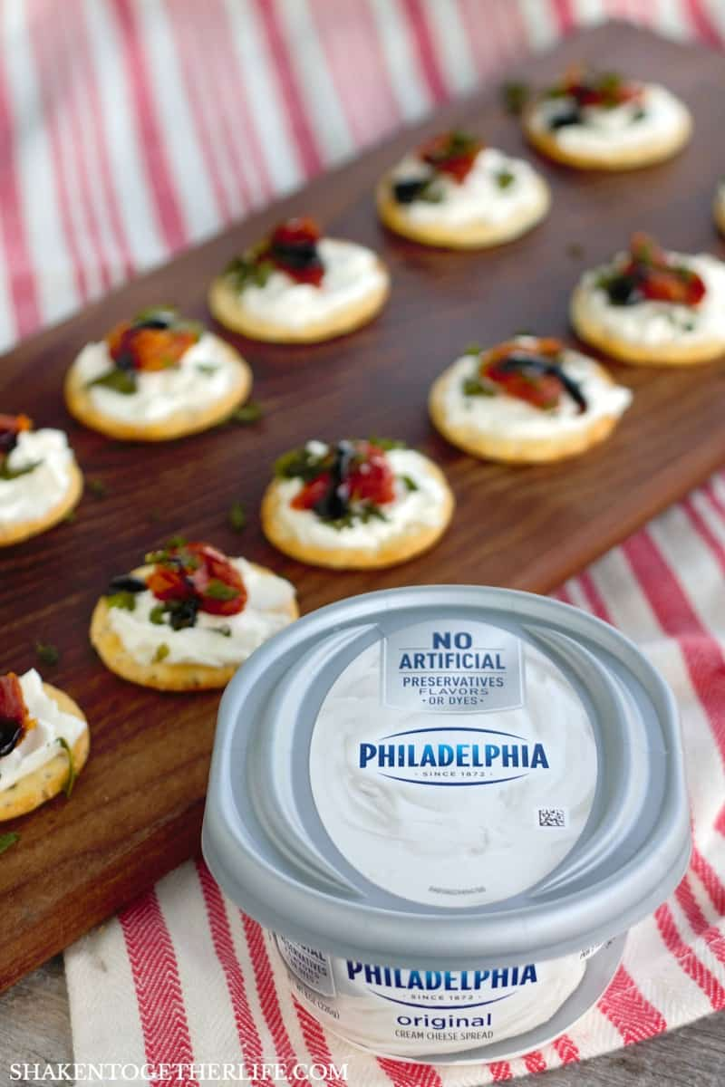 Traditional caprese gets a twist for this easy holiday appetizer: Cream Cheese Caprese Cracker Bites!