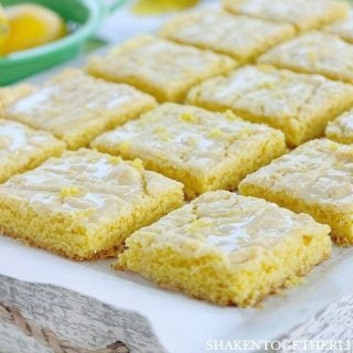 Lemon Glazed Lemon Bars from a cake mix are an easy lemon dessert with big lemon flavor! The 2 ingredient lemon glaze and lemon zest add freshness to these easy lemon bars!