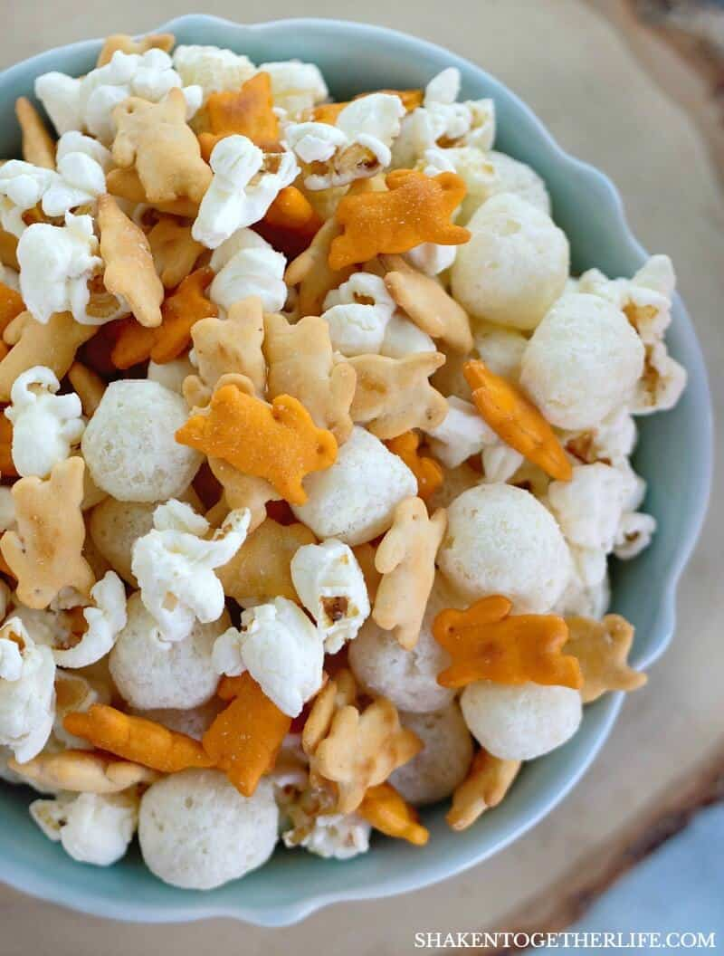 Cheesy Easter Snack mix has just 4 ingredients: cheddar and white cheddar bunny crackers, white cheddar popcorn and white cheddar cheese balls! Crunchy, savory and deliciously addictive!