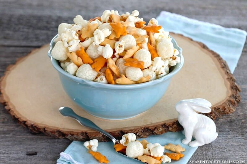 Cheesy Easter Snack Mix! With 4 cheesy ingredients, this savory snack mix is quick to mix up for a pre-dinner treat, egg hunt fuel or a party favor for any Easter or Spring get together!