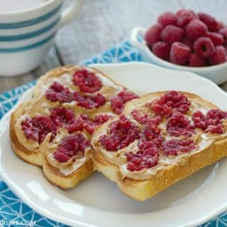 Thick slices of sturdy toasted bread slathered with peanut butter and topped with fresh smashed raspberries makes for a delicious twist on breakfast! Smashed Berry Breakfast Toast is a simple breakfast dish that brightens up breakfast!