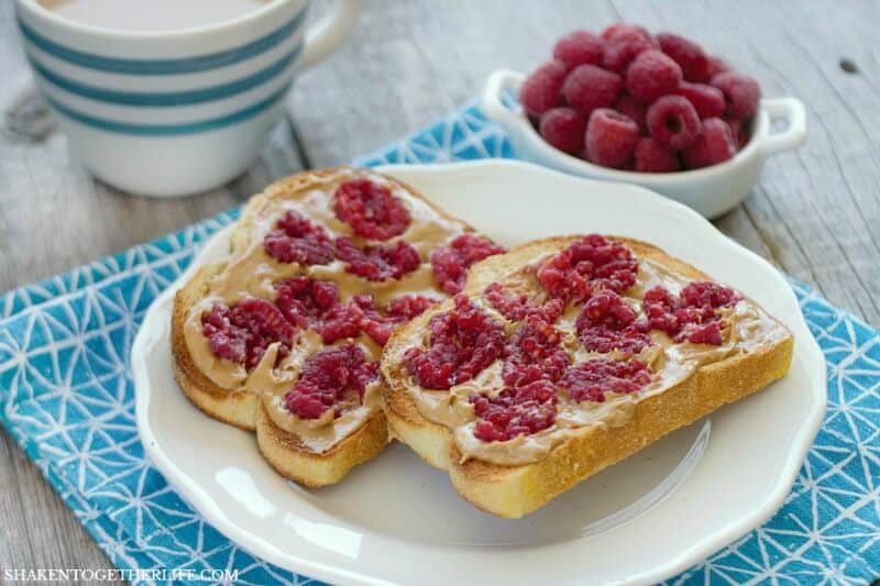 Thick slices of sturdy toasted bread slathered with peanut butter and topped with fresh smashed raspberries makes for a delicious twist on breakfast! Smashed Berry Breakfast Toastis a simple breakfast dish that brightens up breakfast!