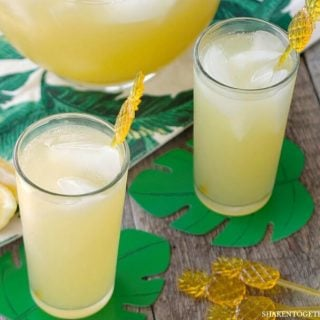 Skinny Sparkling Pineapple Lemonade Punch has 3 ingredients and just 50 calories per glass! This easy to make sparkling pineapple lemonade is perfect to make for parties and sip by the pool all Summer long!