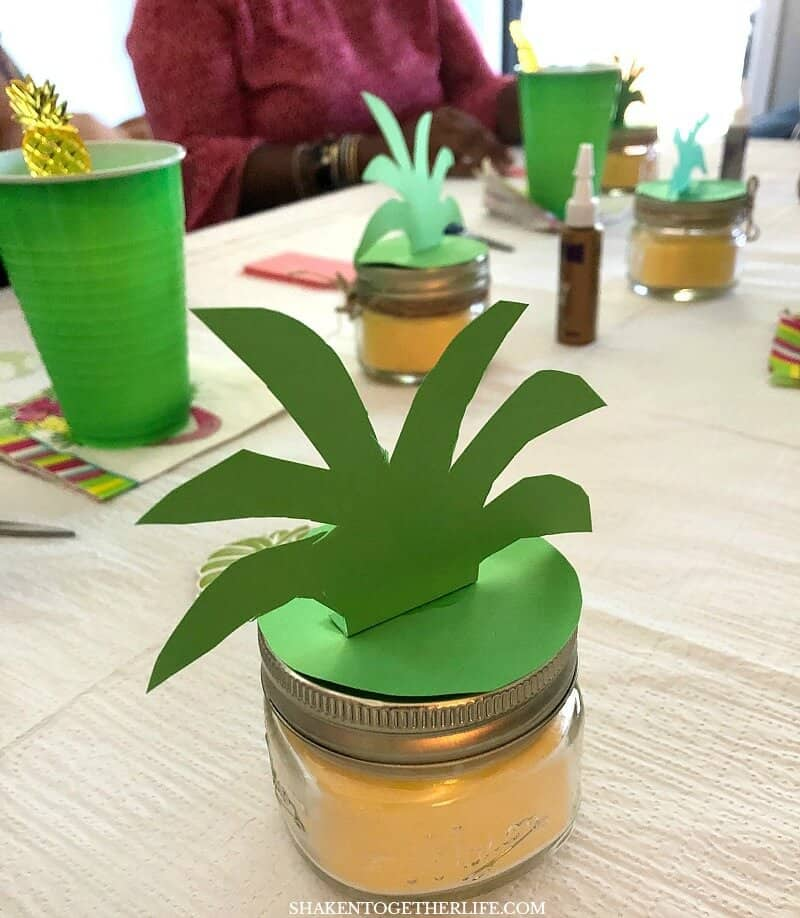 Transform a yellow dollar store candle into a Perky Pineapple Candle with simple paper and twine embellishments - this fun idea is perfect for a Tropical Summer Craft Party