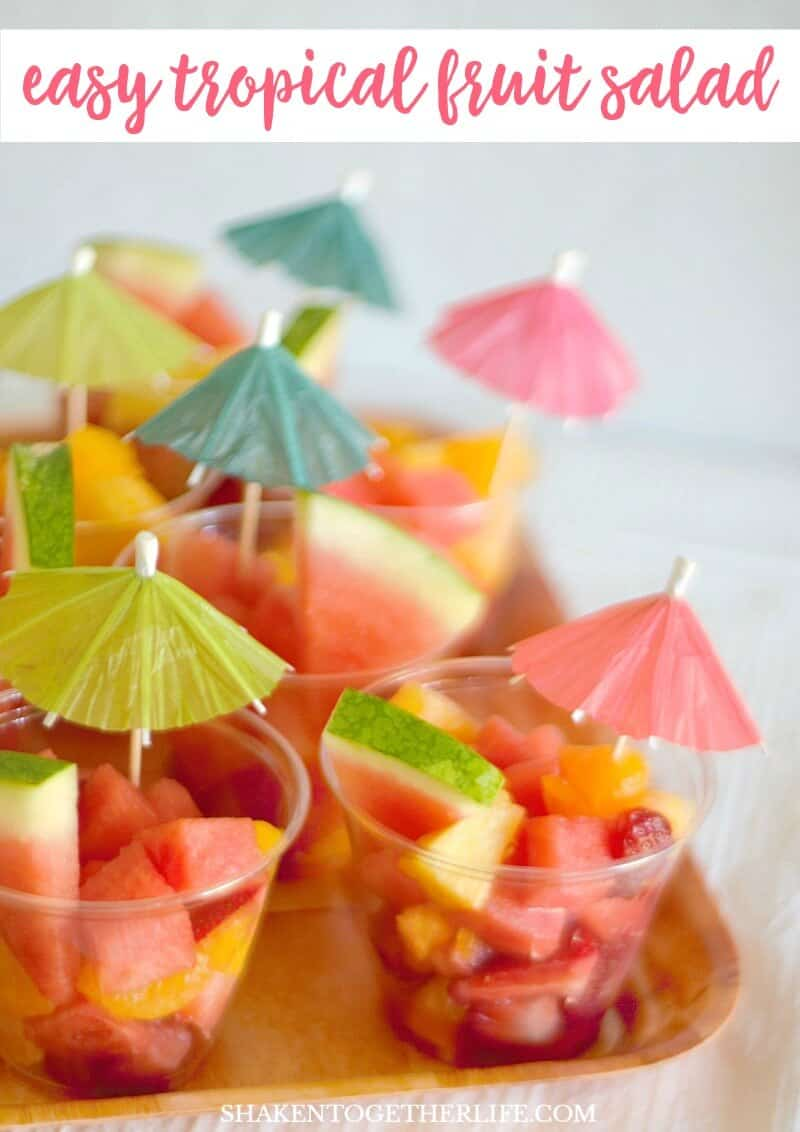 Easy Tropical Fruit Salad served with a paper party umbrella is sweet, healthy & refreshing! It makes the perfect dessert for a Tropical Summer Craft Party!