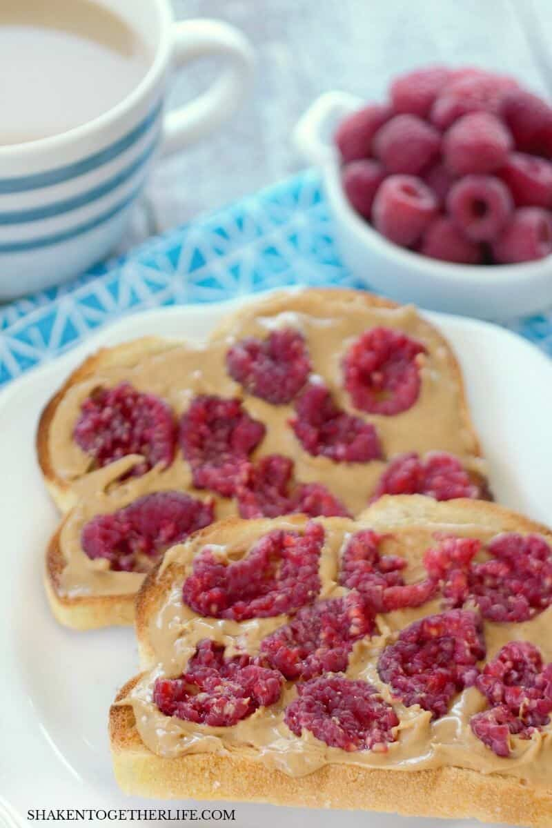Smashed Berry Breakfast Toast with peanut butter and raspberries