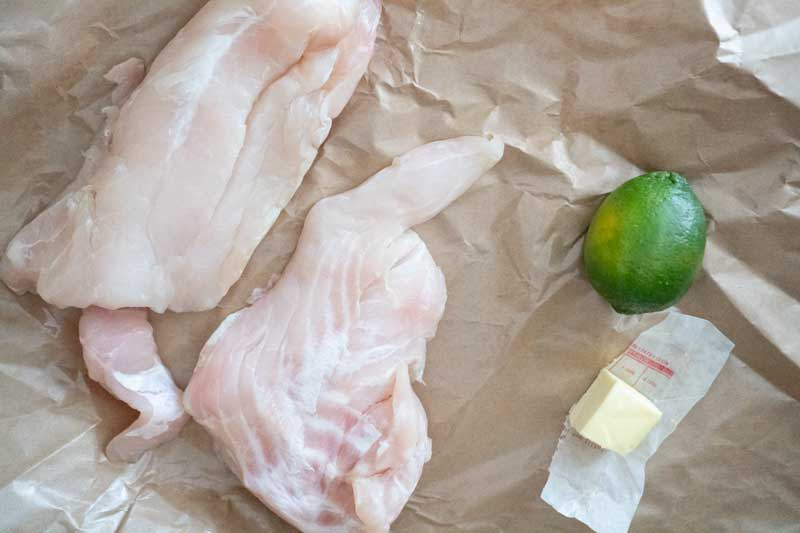 grouper fillets with lime and butter on paper