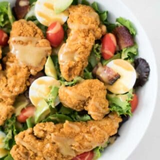 cripsy chicken salad in white bowl
