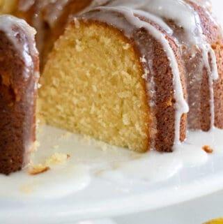 lemon bundt cake on white cake stand