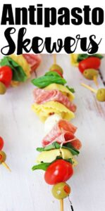 anitpasto kabob skewer on white table with overlay text reading antipasto skewers