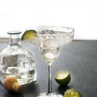 agave margarita in glass with lime
