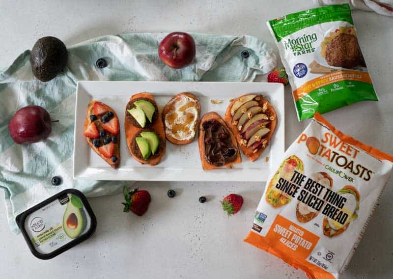 platter with various topped sweet potato toasts and product packages surrounding
