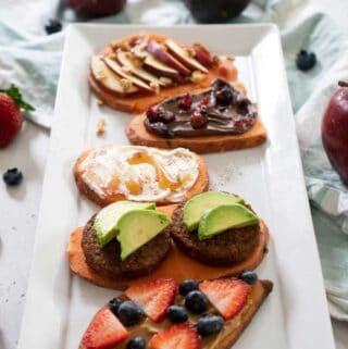 sweet potato toasts on a platter with toppings