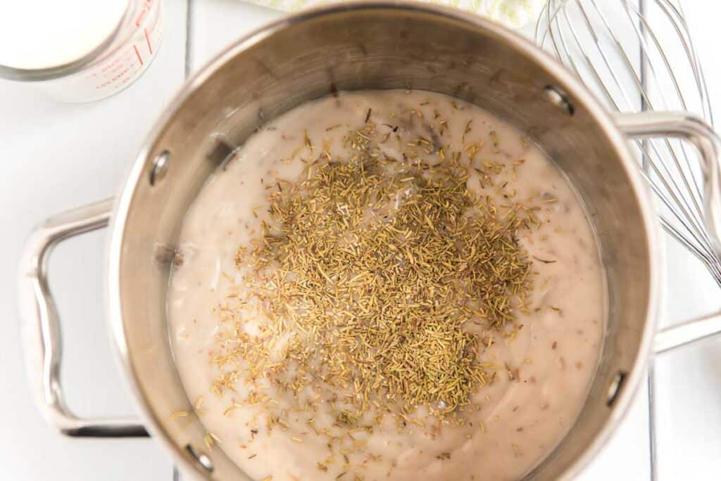 mixing cream of mushroom soup and seasoning in saucepan