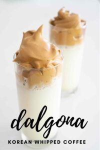 dalgona korean whipped coffee in text in front of two glasses of dalgona