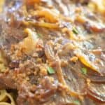 close up of meat over pasta with text reading slow cooker london broil