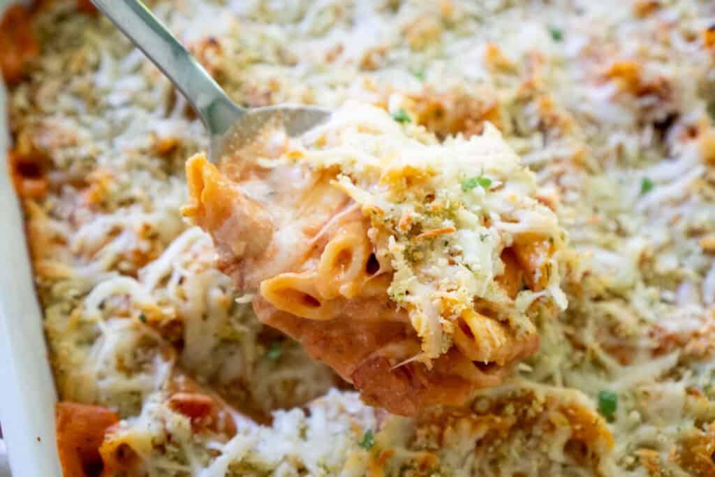 copycat olive garden 5 cheese ziti al forno in serving spoon over white baking dish