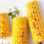 grilled corn on white plate with text reading grilled corn