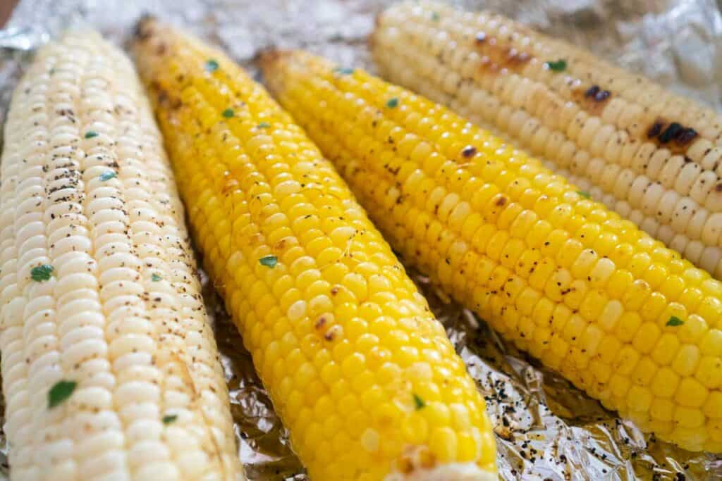 four cobs of corn after grilling in foil