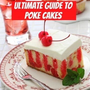cherry poke cake on a china plate with fork and mint sprig