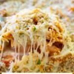 ziti al forno in serving spoon with text reading ziti al forno copycat olive garden recipe