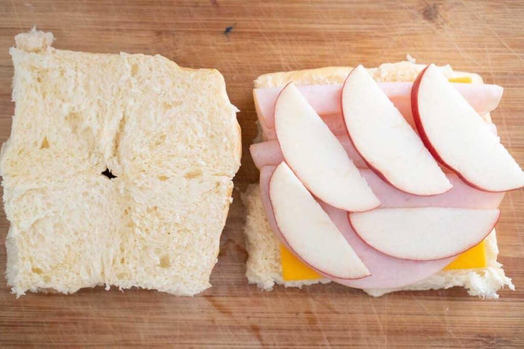 apple turkey and cheese layers on hawaiian roll cut in half