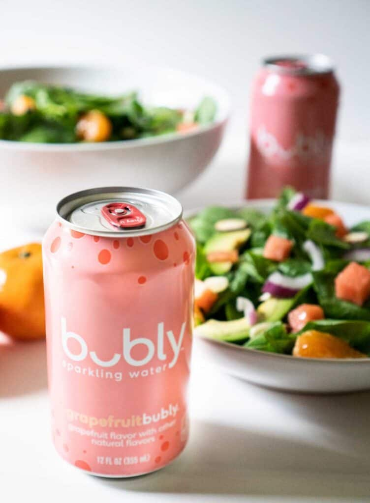 bubly can with salad in background