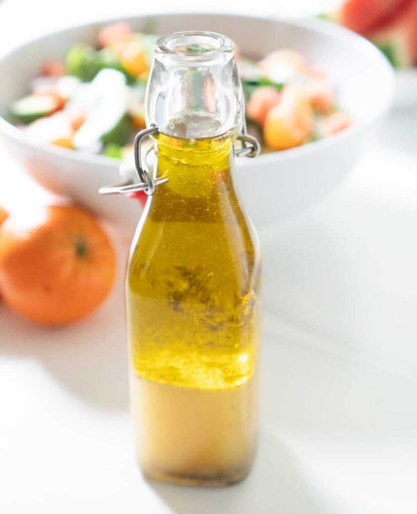 salad dressing in glass bottle before shaking