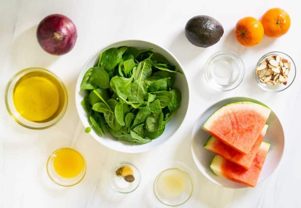 avocado citrus salad ingredients on white counter